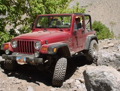 Red Jeep Warnlger in the Rocks